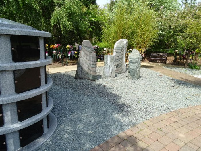 Large plaques and an arrangements of stones in the centre of the reflection garden